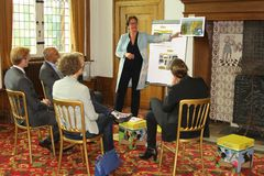 Workshop training durability sustainability, Netherlands. Workshop trainer give lessons in durability and sustainability in a workshop in the castle of Nyenrode stock photography