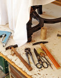 Workshop of the upholsterer, workbench with tools Stock Image