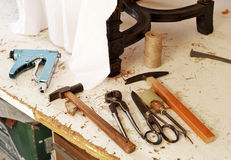 Workshop of the upholsterer, workbench with tools Royalty Free Stock Photo