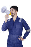 Workshop worker shouting with a megaphone Royalty Free Stock Image