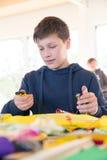 Workshops. Boy build a kite. Workshops Stock Photography