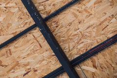 Worksite for installing orient strand board or OSB or Plywood Stock Images