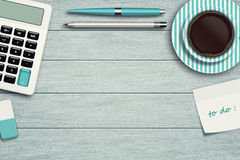 Workspace with calculator, pen, pencil and cup of coffee Royalty Free Stock Image