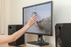 Workspace with calibrator or profiler attached to laptop`s display to get accurate colors. Royalty Free Stock Image