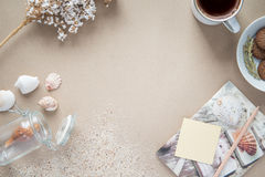 Workspace - coffee, and cookie on table. Background with free te. Desk work in the summer, the vintage, the background color is brown Kraft paper stock image