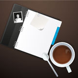 Workspace with coffee cup, instant photos, note paper and notebook on old wooden table Stock Photo