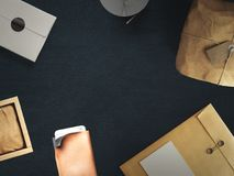 Workspace composed of postal parcel with envelope. Top view. Tools on background Royalty Free Stock Photos