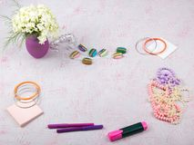 Workspace with computer, bouquet Hydrangeas, clipboard. Women`s fashion accessories isolated on pink background. Flat Royalty Free Stock Photography