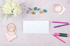 Workspace with computer, bouquet Hydrangeas, clipboard. Women`s fashion accessories  on pink background. Flat Stock Photo