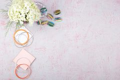 Workspace with computer, bouquet Hydrangeas, clipboard. Women`s fashion accessories  on pink background. Flat Stock Photography