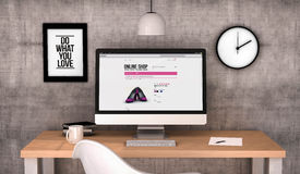Workspace computer desktop with online shop on the screen Royalty Free Stock Photo