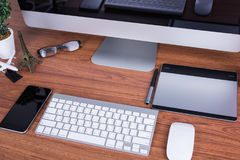 Workspace with blank screen. Workspace computer monitor with blank screen on desk office room Royalty Free Stock Image