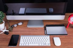 Workspace with blank screen. Workspace computer monitor with blank screen on desk office room Royalty Free Stock Images