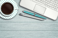 Workspace with computer, pen, pencil and cup of coffee Royalty Free Stock Photos