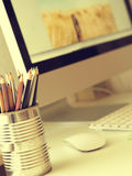 Workspace of a creative. Creatives workspace with selective focus on traditional art pencils Royalty Free Stock Photos