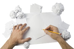 Workspace with crushed paper and hands Royalty Free Stock Photo