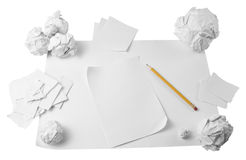 Workspace with crushed paper and pencil Stock Image