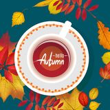 Workspace dark blue desk with autumn foliage and cup of tea. Workspace  dark blue desk with autumn foliage and cup of tea. Hello Autumn lettering. Flat lay Stock Images