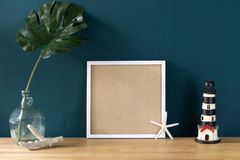 Workspace decoration with white photo frame and tropical monster royalty free stock photos