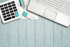 Workspace with graph, computer, graph, calculator and stationery Stock Photos