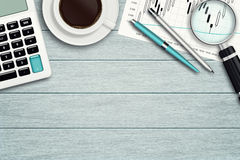 Workspace with graph, loupe, calculator and stationery Stock Images