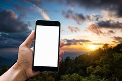 Workspace hand holding smart phone device stock images