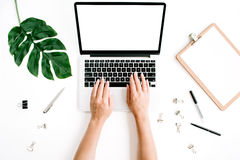 Workspace with hands typing on laptop with blank screen Royalty Free Stock Photography
