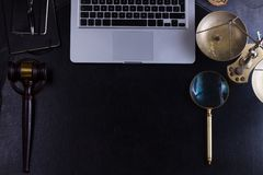 Workspace hero header with law gavel. And laptop keyboard, top view, copy space on black leather desktop Stock Images
