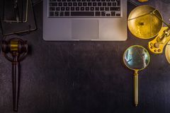 Workspace hero header with law gavel. And laptop keyboard, top view, copy space on black leather desktop, retro toned Royalty Free Stock Photo