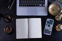 Workspace hero header with law gavel. Legal book and laptop keyboard, open empty notebook, top view flatlay scene Royalty Free Stock Photography