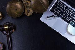 Workspace hero header with law gavel. Scale and laptop keyboard, top view, copy space on desktop Stock Photos