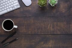 Free Workspace In Office With Wood Table. Top View From Above Of Keyboard With Notebook And Coffee. Desk For Modern Creative Work Of De Stock Images - 185524824