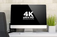 Workspace with 4k computer screen. 3d rendering of workspace with computer with 4k utra HD resolution monitor. All screen graphics are made up Royalty Free Stock Photography