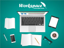 Workspace with laptop, phone, notebook Royalty Free Stock Image