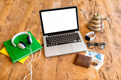 Workspace with laptop on wooden table royalty free stock images