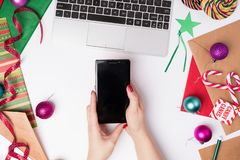Workspace with laptop and wrapping paper, top view. royalty free stock photography