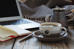 Workspace with modern laptop. And hot coffee Royalty Free Stock Photo