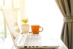 Workspace with modern laptop at sunrise Royalty Free Stock Image