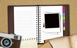 Workspace with notebook ,classic camera,instant photos, note pap Royalty Free Stock Photos