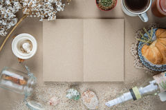 Workspace - Notebook paper with object on table. Background free. Desk work in the summer, the vintage, the background color is brown Kraft paper royalty free stock photography