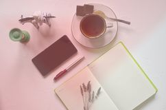 Workspace with notepad, cup of tea on a white background. Flat lay, top view office desk writing desk. Workplace freelancer. stock photos