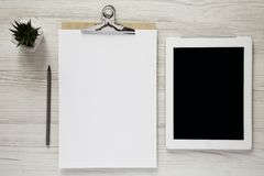 Workspace with noticepad, pencil and tablet, overhead view. Top view royalty free stock image