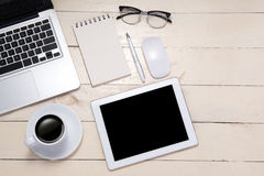 Workspace. Pen, eyeglasses, coffee and notebook on table. Top vi Stock Photos