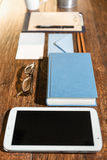 Workspace with tablet and book Stock Images