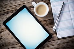 Workspace with tablet and coffee Royalty Free Stock Photos