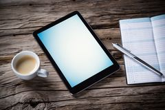 Workspace with tablet and coffee Royalty Free Stock Image