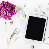 Workspace. tablet, lavender, wedding photo album, bouquet of flowers on white background Royalty Free Stock Photos