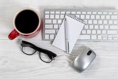 Workspace with technology and coffee on white desktop Royalty Free Stock Photos