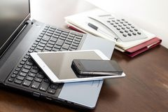 Workspace. Technology on the table Stock Images