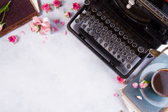 Workspace with vintage typewriter. Cup of coffee and books Royalty Free Stock Images